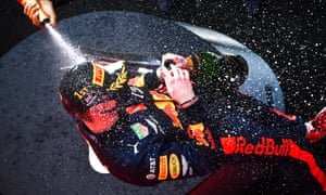Max Verstappen is showered in champagne.