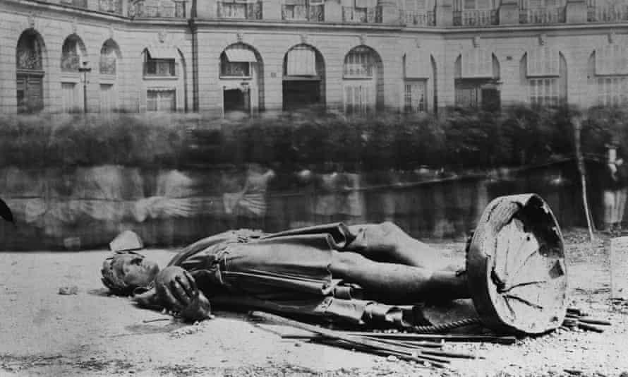 A statue of Napoleon lies broken in the Place Vendome.