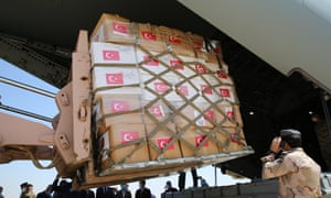 Medical aid packages are unloaded from a Turkish Armed Forces' plane upon its arrival in Baghdad Airport today.