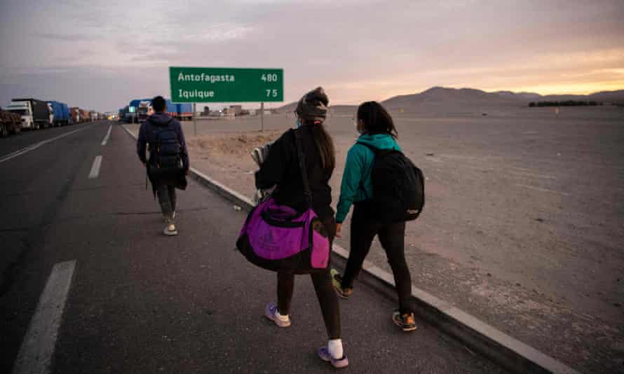 Venezuelan migrants Reinaldo, left, 26, Anyier, 40, and her daughter Danyierly, 14, cross the highlands on the border between Bolivia and Chile on foot.