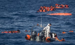 A rescue mission off Lampedusa, Italy, after a wooden boat carrying more than 500 people partially capsized, in May 2017