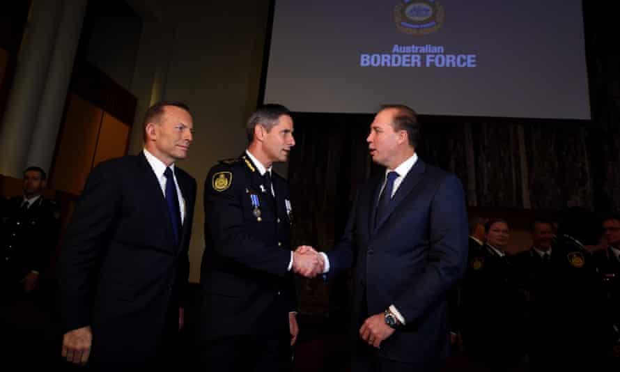 Tony Abbott (left), immigration minister Peter Dutton,(right), congratulate new commissioner of the Australian Border Force, Roman Quaedvlieg.
