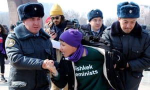 Kyrgyz police detains an activist of the FEMEN women's movement on Victory Square during the celebration of International Women's Day in Bishkek, Kyrgyzstan, 08 March 2020.