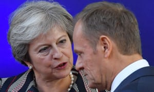 Theresa May speaks with the European council president, Donald Tusk