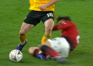 Manchester United's Victor Lindelof slides in and clatters Wolverhampton Wanderers' Diogo Jota.