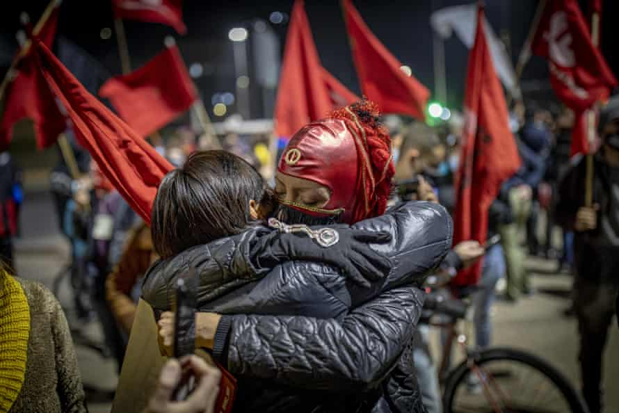 Communist party members in Santiago celebrate their victories in the constitutional assembly elections.