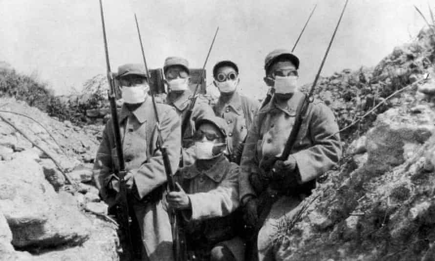 French troops wearing an early form of gas mask in the trenches during the 2nd Battle of Ypres