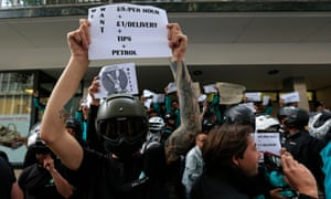Deliveroo riders protest over pay outside the company HQ in Torrington Place, London, on 11 August 2016.