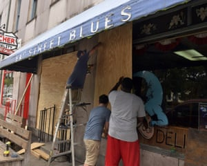 Workers board the windows of the Bay Street Blues today in preparation of the potential arrival of Hurricane Dorian