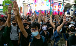 Protesters hold up the three-finger salute during a rally in Bangkok, Thailand.