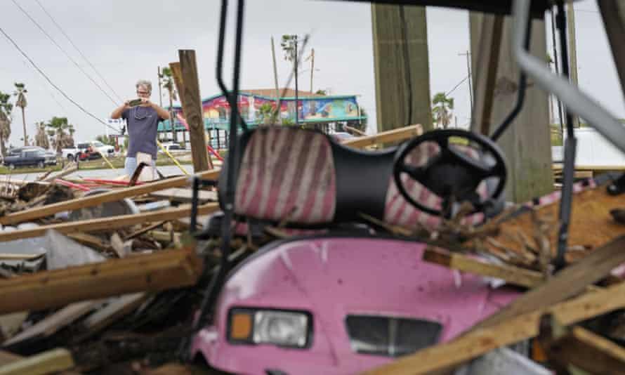 Gary Goerner surveys the damage from Hurricane Nicholas as he walks through his neighborhood in San Luis Pass, Texas.