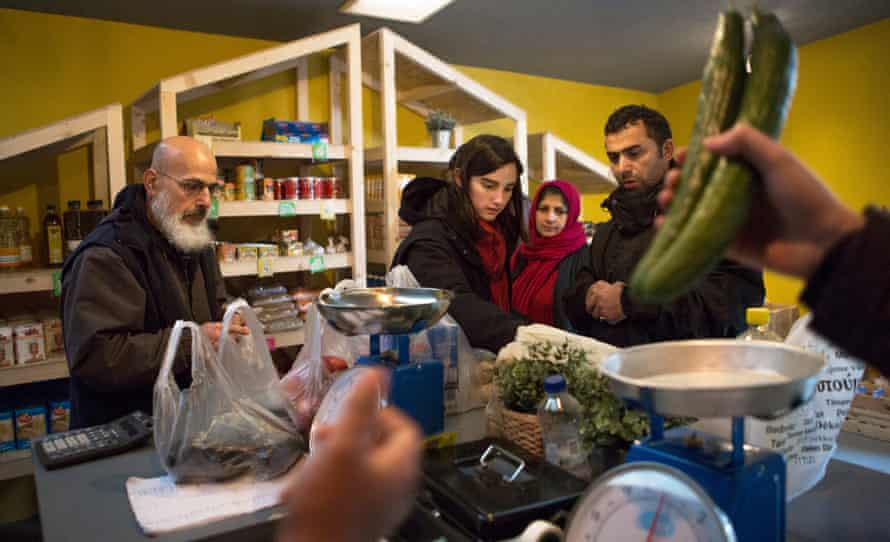 Refugee Support Europe intiatives in Katsika, Epirus, Greece For use in Weekend magazine, 15/09/2018. DO NOT USE BEFORE THIS DATE Refugees shopping in the grocery store of Refugee Support Europe run by volunteers at the Katsikas refugee camp in Greece