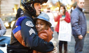 Portland police sergeant Bret Barnum and Devonte Hart hug at a rally in Portland in November 2014. The photo drew national attention.