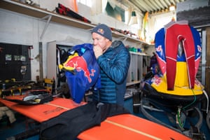 Cotton checks and prepares his kit at Red Bull's facility in an old shipping yard in Nazaré.