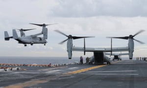 US Marine MV-22B Osprey aircraft land on the USS Bonhomme Richard, during events marking the start of Talisman Saber 2017, off the coast of Sydney.