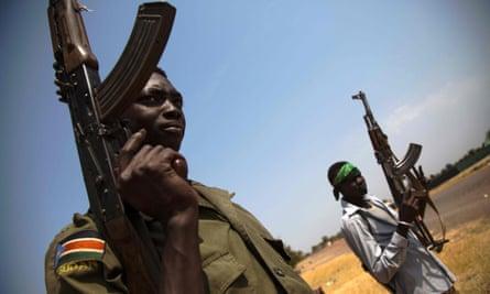 Members of the SPLA patrol the half-emptied village of Leer, on 3 February 2016.