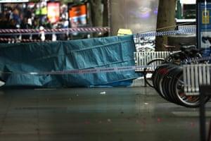 Police tape seen on Bourke St.
