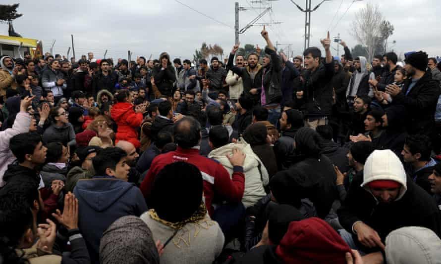 Stranded refugees at the Greek-Macedonian border as they wait for the crossing to reopen.