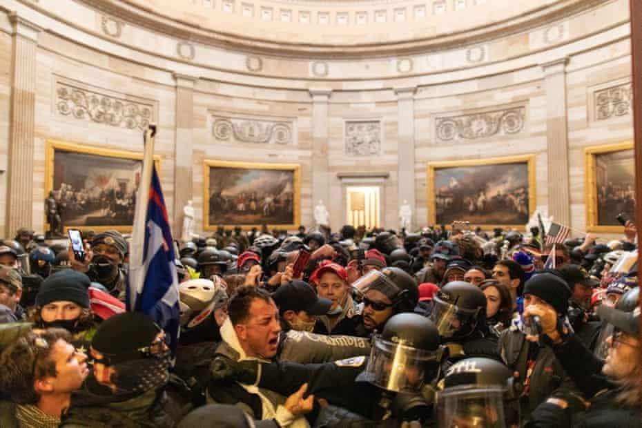 Police intervene against Trump supporters who breached security and entered the Capitol building.