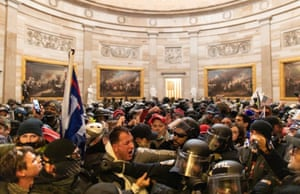 Washington DC, US – Police attempt to stop Trump supporters who breached security and entered the Capitol building.