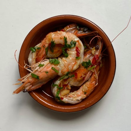 Jose Pizarro's garlic prawns: remove the shells but leaves the heads and tails on.