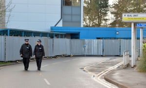 Police officers patrol the quarantined area outside Arrowe Park hospital, Wirral