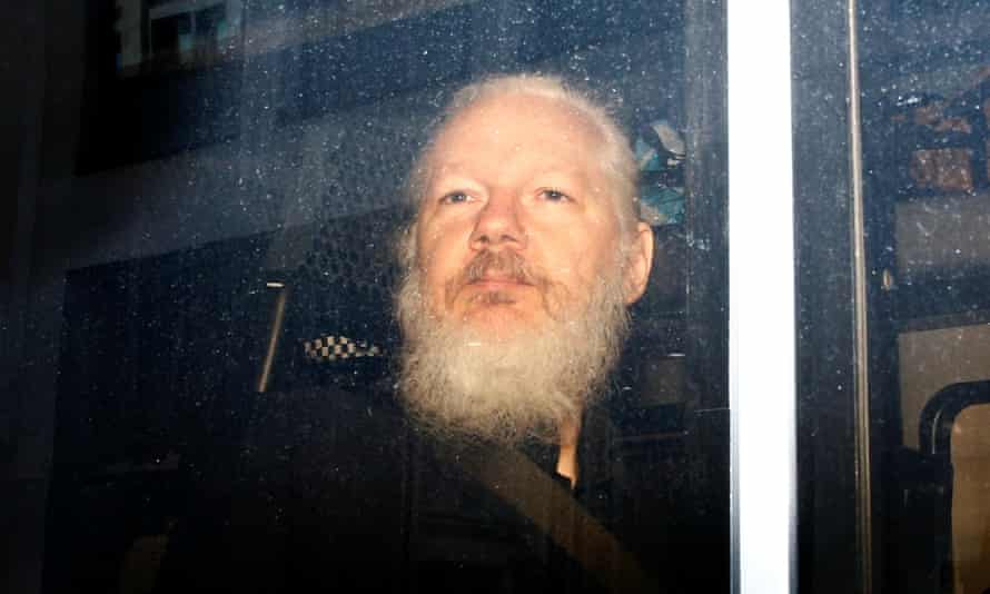 Julian Assange is seen in a police van after he was arrested by British police in London on 11 April.