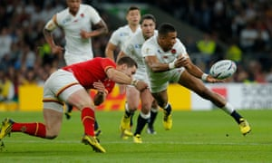 Anthony Watson passes as George North comes to tackle