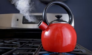A red teapot on the boil.