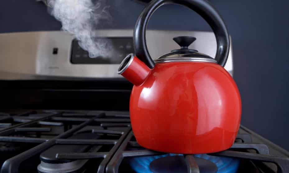 Red kettle boiling on a stove