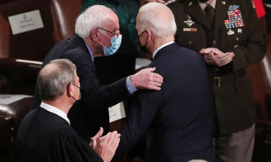 Biden is greeted by Senator Bernie Sanders as he arrives for the address.