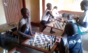 Children take on each other at the Katwe chess academy in Kampala