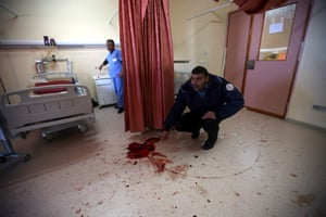In Hebron, a Palestinian hospital security guard checks the room at the Al-Ahli hospital where Israeli special forces killed 27-year-old Abdallah Shalaldeh and arrested his cousin