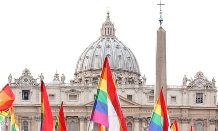 Italian gay rights activists hold their flags in Rome during a demonstration in front of the Vatican
