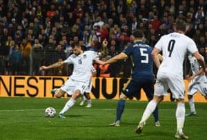 Francesco Acerbi scores Italy's first.