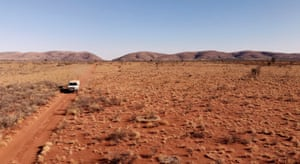Ryder and Kelly's car drives across the landscape.