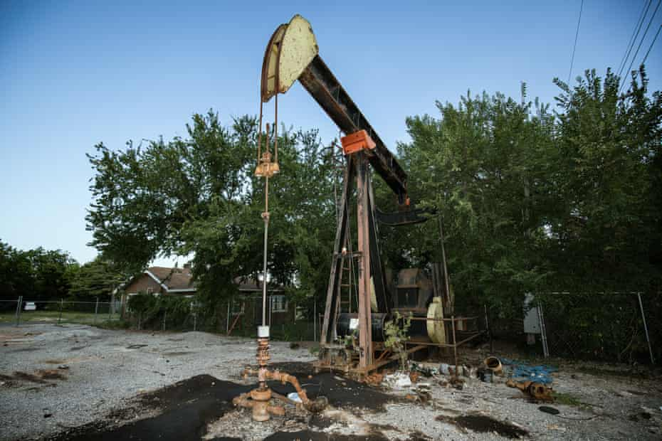 A pump jack rests idle in a residential lot of a lower income neighborhood in Oklahoma City.