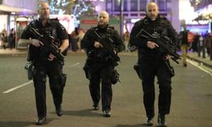 Armed police patrol near Oxford Street on 24 November 24.