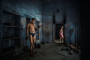 A gym in Varanasi, India, with basic fitness equipment. While I was busy shooting this young man with a fantastic physique, an older man walked into the frame.