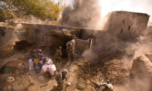 American soldiers of the 101st Airborne blow up a compound suspected of containing IEDs in a village in Panjwai district in 2010.