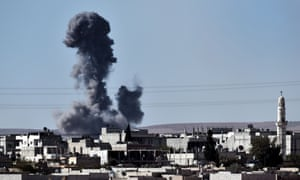 Smoke rises from the southwest of the Syrian town of Kobane following air strikes by the US-led coalition against positions held by Islamic State.