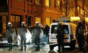Police at the scene tonight of a security operation in the Brussels suburb of Molenbeek in Brussels.