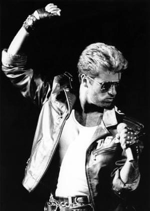George Michael performing on stage.