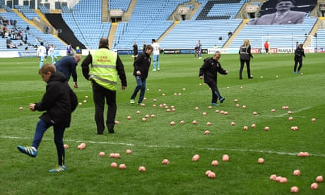 Coventry v Charlton match delayed owing to flying plastic pigs