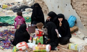 Women fleeing the Syrian war at a checkpoint in Harjala village