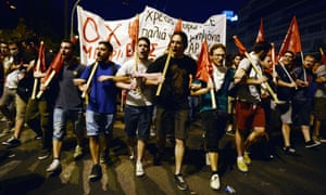 Protesters march on the Greek parliament in Athens during an anti-austerity protest.