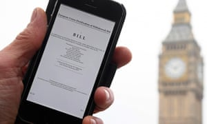 A man poses with an electronic copy of the Brexit article 50 bill on his phone, outside parliament