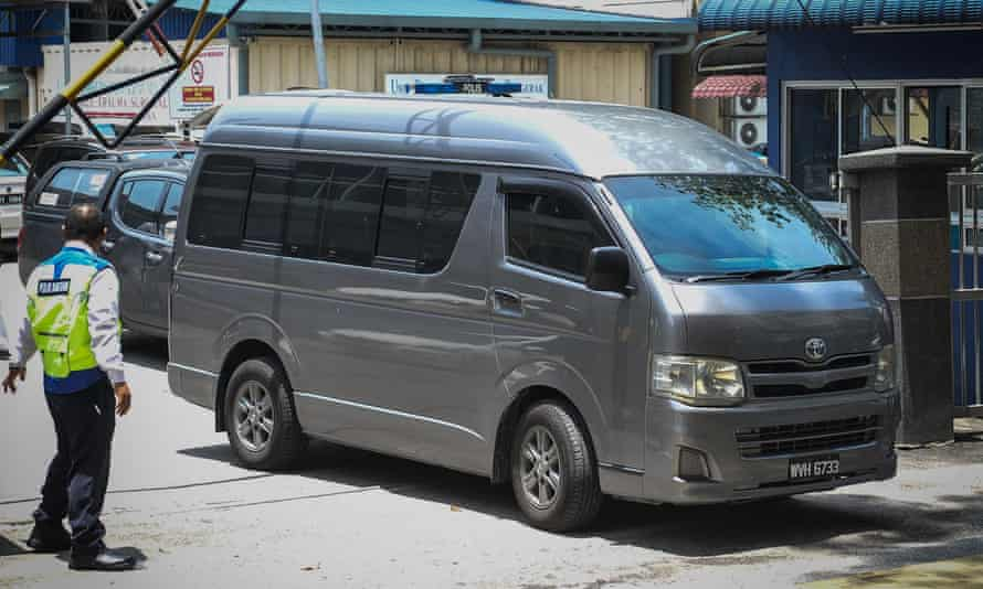 A van possibly carrying the body of Kim Jong-nam leaves a hospital in Kuala Lumpur.