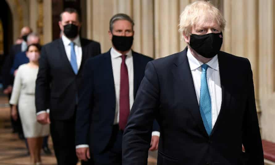Boris Johnson walks through the Central Lobby from the House of Lords before the Queen's speech in parliament on Tuesday.