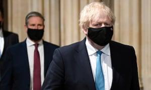 Prime minister Boris Johnson and Labour leader Keir Starmer walk through the central lobby.